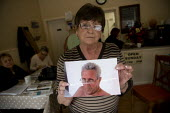 Christine Dalziel with a picture of her husband George who died at Stafford hospital. The campaign group Cure the NHS at their HQ in Stafford. Hundreds of patients suffered and died unnecessarily as a... - John Harris - 2000s,2009,activist,activists,against,and,appalling,bodies,body,campaign,campaigner,campaigners,campaigning,CAMPAIGNS,communities,community,dead,dead body,death,deaths,DEMONSTRATING,DEMONSTRATION,DEMO