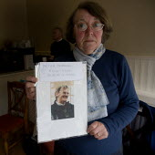Sonia Burnhill with a picture of her husband Peter who died at Stafford hospital. The campaign group Cure the NHS at their HQ. Hundreds of patients suffered and died unnecessarily as a result of appal... - John Harris - 2000s,2009,activist,activists,and,appalling,bodies,body,campaign,campaigner,campaigners,campaigning,CAMPAIGNS,care,communities,community,dead,dead body,death,deaths,died,emotion,emotional,emotions,fai