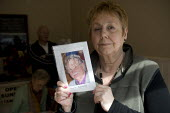 Gillian Peecham with a picture of her husband Arther who died at Stafford hospital. The campaign group Cure the NHS at their HQ in Stafford.. Hundreds of patients suffered and died unnecessarily as a... - John Harris - 2000s,2009,activist,activists,against,and,appalling,bodies,body,campaign,campaigner,campaigners,campaigning,CAMPAIGNS,communities,community,dead,dead body,death,deaths,DEMONSTRATING,demonstration,DEMO