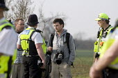 Police Forward Intelligence officers (FIT) questioning a press photographer for photographing the team photographing and filming protesters under new anti terrorist legislation. He was threatened unde... - John Harris - 22-03-2009