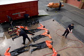 Firefighters cleaning Dry Suits at Perry Barr Fire station Birmingham. - John Harris - 17-04-2009