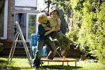 Boys wrestling in the garden. - John Harris - 23-05-2009