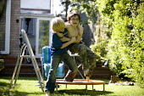 Boys wrestling in the garden. - John Harris - 2000s,2009,boy,boys,child,childhood,children,emilio,friend,friends,friendship,friendships,garden,gardens,holiday,holidays,home,house,houses,housing,juvenile,juveniles,kid,kids,Leisure,LFL,LIFE,male,pe