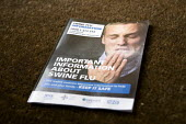 Government Swine flu information leaflet showing a man sneezing and spreading the virus. - John Harris - 15-05-2009
