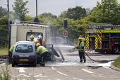 Fire service attend an incident in which a camper van has caught fire. Worcestershire. - John Harris - 08-06-2009