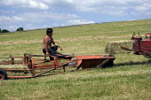 Bailing hay on a farm in Wawickshire - John Harris - 24-06-2009