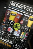 Advertisement for cheap alcoholic drinks in the window of a Weatherspoons. - John Harris - 13-06-2009