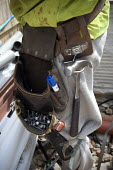 A roofer's utility belt with hammer and nails. Building site, Warwickshire. - John Harris - 24-07-2009