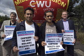 CWU protest against the victimisation of officials at carphone Warehouse. Sulinder Kumar and Kulwinder Plaha and Andy Kerr, CWU dep gen sec. - John Harris - 2000s,2009,ACTIVIST,ACTIVISTS,against,BAME,BAMEs,banner,banners,Black,BME,bmes,campaign,campaigner,campaigners,campaigning,CAMPAIGNS,CWU,DEMONSTRATING,demonstration,DEMONSTRATIONS,diversity,ethnic,eth