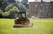 Weed cutting or topping grass on an country estate, Warwickshire - John Harris - 2000s,2009,AFFLUENCE,AFFLUENT,agricultural,agriculture,back,Bourgeoisie,capitalism,capitalist,crop,crops,cut,cutter,cutters,cutting,EARNINGS,EBF,Economic,Economy,elite,elitism,employee,employees,Emplo