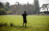 A Farmworker talking on his mobile phone on a country estate in Warwickshire. - John Harris - 02-07-2009