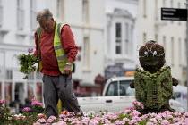 Council workers planting bedding plants. - John Harris - 15-07-2009