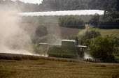 Plume of dust. Harvesting wheat on a farm in Worcestershire using a combine harvester - John Harris - 2000s,2009,agricultural,agriculture,capitalism,capitalist,cereal crop,country,countryside,crop,crops,driver,drivers,driving,EBF,Economic,Economy,employee,employees,Employment,farm,Farm Worker,farm wor