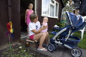 Polish migrants living in a one room chalet in the garden with their baby daughter aged 5 months. - John Harris - 08-08-2009