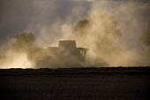 Combine harvester cutting wheat, Rutland. - John Harris - 23-08-2009