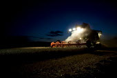 Combine harvester cutting wheat, Rutland. - John Harris - 2000s,2009,agricultural,agriculture,at,capitalism,capitalist,cereal crop,crop,crops,cutting,driver,drivers,driving,EBF,Economic,Economy,employee,employees,Employment,farm,Farm Worker,farm workers,farm