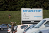 Does God exist? Advertisement for Christian education courses on existence of God and The Meaning Of Life, M6 Motorway Services car park. - John Harris - &,2000s,2009,advert,ADVERTISED,advertisement,advertisements,advertising,ADVERTISMENT,adverts,Atheism,Atheist,Atheists,AUTO,AUTOMOBILE,AUTOMOBILES,belief,billboard,billboards,car,CARS,christian,christi