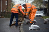 Council workers sweeping up and clearing autumn leaves from the village streets, Quorn, Leicestershire. - John Harris - 13-10-2009