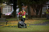 Council contractors clearing up autumn leaves in a Park. Stratford upon Avon, Warwickshire - John Harris - 16-10-2009