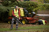 Council contractors clearing up autumn leaves in a Park. Stratford upon Avon, Warwickshire. Using a leaf blower. - John Harris - 16-10-2009