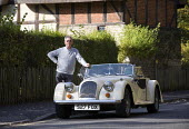 Man with his Morgan sports car bought for his retirement. - John Harris - 16-10-2009
