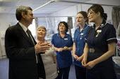 Dave Prentis Unison talking to members about the difficulties and issues on a ward whilst visiting Mid Staffordshire Hospital Stafford - Duncan Phillips - 2010,2010s,care,communicating,communication,conversation,conversations,dialogue,discourse,discuss,discusses,discussing,discussion,FEMALE,health,HEALTH SERVICES,Health Worker,Health Workers,healthcare,