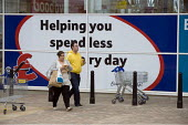 Helping you spend less every day. Shoppers at a new Tesco supermarket in Telford - John Harris - 27-03-2010