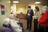 Andy Burnham talking to outpatients whilst visiting Rowley Regis Hospital, West Midlands. - John Harris - 2010,2010s,age,ageing population,campaign,campaigning,CAMPAIGNS,care,communicating,communication,conversation,conversations,DEMOCRACY,dialogue,discourse,discuss,discusses,discussing,discussion,elderly