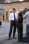David Miliband MP on his Labour leadership campaign tour in Worcester. Being interviewed by a TV journalist. - John Harris - 13-05-2010