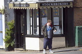 A youth waiting outside a Stockbrokers shop. - John Harris - 20-05-2010