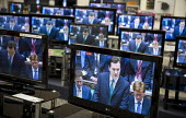 Budget speech to Parliament by George Osborne seen on televisons in a Currys store. - John Harris - 22-06-2010