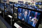 Televised budget speech to Parliament by George Osborne seen on televisons in a Currys store. - John Harris - 22-06-2010