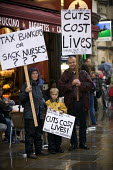 Kathy, son Isaac (who has muscular dystrophy) and Stuart White Tax bankers or sack nurses? placard. Heath workers and their supporters protest against proposed job cuts, Oxford. �45m of NHS cuts are t... - John Harris - 29-09-2010