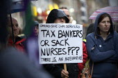 Tax bankers or sack nurses? placard. Heath workers and their supporters protest against proposed job cuts, Oxford. �45m of NHS cuts are to be made in Oxfordshire in the county. Unison says NHS Oxfords... - John Harris - 29-09-2010