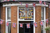 Bunting and a commemorative poster of the Royal couple, Royal Wedding Day, Stratford upon Avon, Warwickshire - John Harris - 2010s,2011,ACE,adult,adults,commemorative,couple,COUPLES,culture,flag,flags,LFL,LIFE,Lifestyle,MARRIAGE,MATURE,memorabilia,Monarchy,nationalism,PEOPLE,poster,POSTERS,royal,royalty,Social Issues,soi,Wa