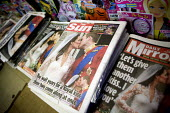 Reporting of the Royal Wedding. Front pages of The Sun and The Mirror tabloid newspapers showing the kiss between the Prince William and Kate Middelton, now Duchess of Cambridge on the balcony at Buck... - John Harris - 30-04-2011
