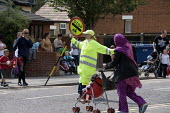 School crossing patrol officer with a Lollypop, helping parents and pupils to cross the road safely, Ipswich - John Harris - 2010,2010s,asian,asians,BAME,BAMEs,Black,BME,bmes,child,CHILDHOOD,children,cross,crosses,crossing,diversity,EARNINGS,employee,employees,Employment,EQUALITY,ethnic,ethnicity,FEMALE,helping,highway,Inco
