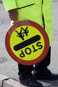 School crossing patrol officer with a Lollypop, helping parents and pupils to cross the road safely, Ipswich - John Harris - 27-01-2010