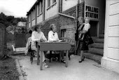 Woman voter comes out of a Polling Station in Tredegar, South Wales 1987 - John Harris - 11-06-1987
