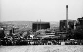 Ranked lines of police officers and riot police officers prevent striking miners from approaching the Orgreave coking plant to picket during the miners' strike. - John Harris - 28-05-1984