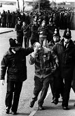 Striking miners injured and arrested during a mass picket of the Orgreave coking plant during the miners' strike. - John Harris - 28-05-1984