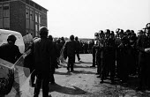 Uniformed police officers applaud riot officers as they return from their duties at a mass picket of the Orgreave coking plant during the miners strike. - John Harris - 1980s,1984,adult,adults,applaud applauding,applauding,applause,Battle of Orgreave,BSC,clap,clap clapping,clapping,CLJ,coke works,coking plant,conflicts conflict,DISPUTE,disputes,force,INDUSTRIAL DISPU