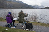 Artists sketching The Snowdon Massif, Llyn Padarn, Snowdonia National Park - John Harris - &,2010s,2013,ACE,age,ageing population,amateur,art,arts,artwork,artworks,country,countryside,culture,day out,Day Trip,draw,drawing,elderly,FEMALE,friend,friends,friendship,friendships,hobbies,hobby,ho