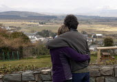 A couple taking in the a view of the Snowdonia National Park. - John Harris - 19-03-2013