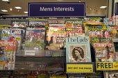 Gender stereotyping in a display of Mens Interests leisure magazines on a rack at Morrisons supermarket - sport, shooting, fishing, cycling cricket etc.. The Lady magazine is hot off the press. - John Harris - 27-01-2010