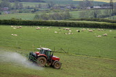 A farmworker crop spraying with a tractor and rig on a farm in Oxfordshire - John Harris - 21-05-2012