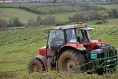 A farmworker climbing into his cab. Crop spraying with a tractor and rig on a farm in Oxfordshire - John Harris - 21-05-2012