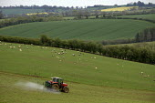 A farmworker crop spraying with a tractor and rig on a farm in Oxfordshire - John Harris - 2010s,2012,agricultural,agriculture,agrochemicals,capitalism,capitalist,crop,crops,driver,drivers,driving,EARNINGS,EBF,Economic,Economy,employee,employees,Employment,eni,environment,Environmental degr