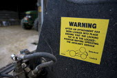 Warning notice on a Telehandler arm in a farmyard Wormleighton, Warwickshire - John Harris - 22-05-2012