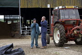 Farmer and farmworker discussing the work to be done, Wormleighton, Warwickshire - John Harris - 2010s,2012,agricultural,agriculture,boss,bosses,capitalism,capitalist,communicating,communication,conversation,conversations,dialogue,discourse,discuss,discusses,discussing,discussion,EARNINGS,EBF,Eco